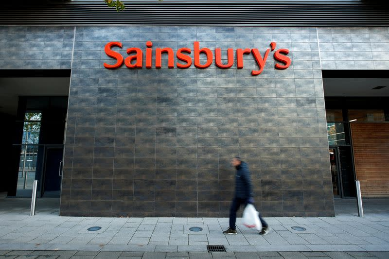 FILE PHOTO: A person walks past a Sainsbury's store in Milton Keynes