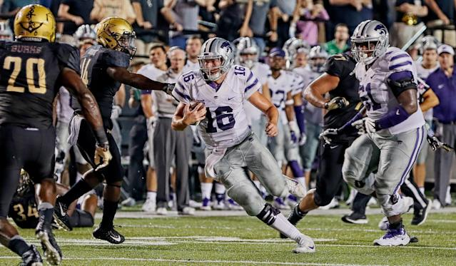 """<a class=""""link rapid-noclick-resp"""" href=""""/ncaaf/players/228393/"""" data-ylk=""""slk:Jesse Ertz"""">Jesse Ertz</a> rushes to gain a first down during the final moments of a 14-7 Vanderbilt victory over Kansas State (Photo by Frederick Breedon/Getty Images)"""
