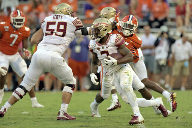 Florida State's Cam Akers (3) rushes out of the backfield for a first down during the second half of an NCAA college football game against Clemson Saturday, Oct. 12, 2019, in Clemson, S.C. (AP Photo/Richard Shiro)