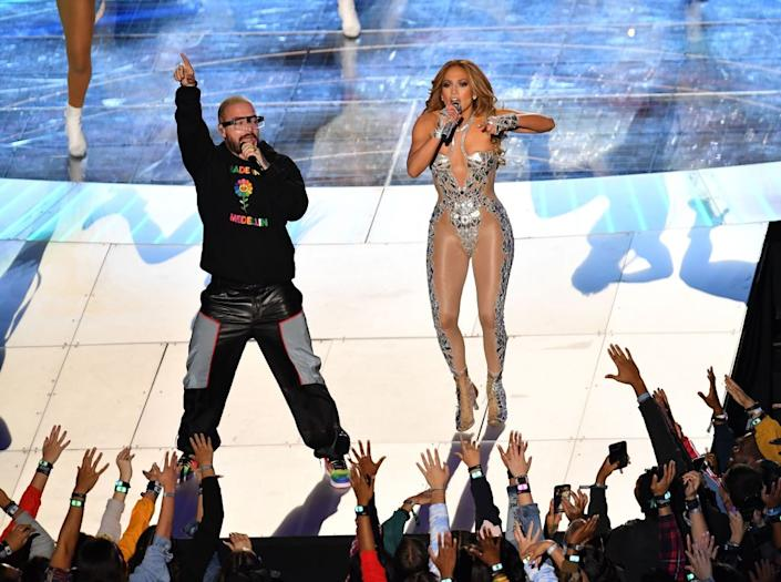 Jennifer Lopez and Colombian singer J Balvin perform during the halftime show of Super Bowl LIV between the Kansas City Chiefs and the San Francisco 49ers at Hard Rock Stadium in Miami Gardens, Florida, on February 2, 2020.   Photo by ANGELA WEISS/AFP via Getty Images)