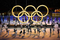 <p>TOKYO, JAPAN - JULY 23: Performers act out a routine in-front of the Olympic Rings during the Opening Ceremony of the Tokyo 2020 Olympic Games at Olympic Stadium on July 23, 2021 in Tokyo, Japan. (Photo by Dylan Martinez - Pool/Getty Images)</p>