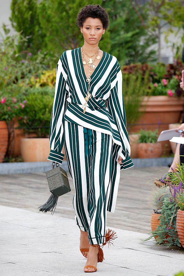 <p>If Meghan had a vacation look, it would be this striped Oscar de la Renta two-piece set from the designer's spring 2019 show. It's classy, elegant, and fashion-forward. (Photo: Getty Images) </p>