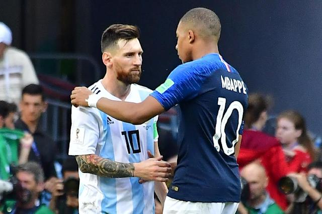 Kylian Mbappe with Lionel Messi after France eliminated Argentina in the last 16 (AFP Photo/Luis Acosta)
