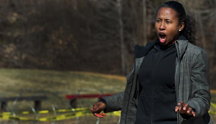Al-Jazeera TV camera woman Trudy Hutcherson reacts as she is targeted with the Active Denial System, March 9th, 2012,  at the US Marine Corps Base Quantico, Virginia. (Paul J. Richards/AFP via Getty Images)