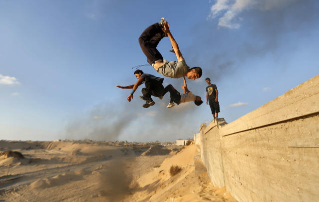 Palestinian youths practice their parkour skills in Khan Younis in the southern Gaza Strip September 12, 2012. Some youths, aged between 12 and 23 years old, in Gaza are training in parkour which was developed in France. Parkour is a physical discipline of movement focused on overcoming obstacles. Training is held in cemeteries, and in former Israeli settlements. REUTERS/Mohammed Salem (GAZA - Tags: SOCIETY SPORT TPX IMAGES OF THE DAY)