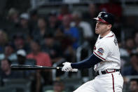 Atlanta Braves' Freddie Freeman watches his home run during the sixth inning of the team's baseball game against the Boston Red Sox on Wednesday, June 16, 2021, in Atlanta. (AP Photo/John Bazemore)