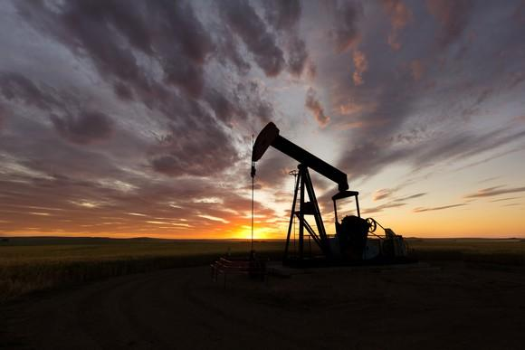 An oil pump with a spectacular sunset in the background.