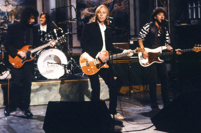 <p>Tom Petty and the Heartbreakers perform on <i>Saturday Night Live,</i> May 20, 1989, in New York City. (Photo: Raymond Bonar/NBC/Getty Images) </p>