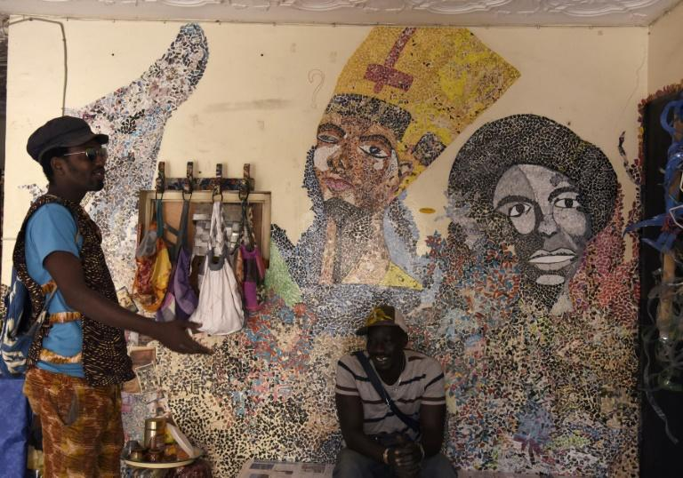 Mamadou Boye Diallo((L), the founder of the Yataal Art fair, is also a local guide