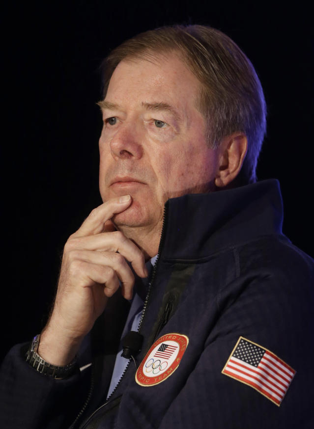 FILE - In this Oct. 1, 2-13 file photo, U.S. Olympic Committee Chairman Larry Probst listens during a news conference in Park City, Utah. If Boston, Los Angeles, San Francisco or Washington are picked as a candidate to host the 2024 Olympics, the U.S. Olympic Committee might not feel like a winner right away. One of its first tasks will be to hand over millions in sponsorship cash to the winning city's new organizing committee. (AP Photo/Rick Bowmer, File)