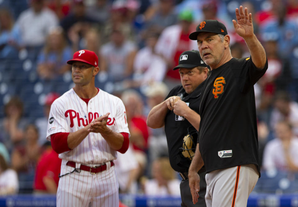 Former Phillies manager Gabe Kapler (left) is reportedly interviewing to replace Bruce Bochy as Giants manager. (Getty)