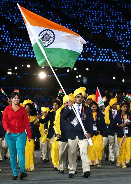 Sushil Kumar of the India Olympic wrestling team carries his country's flag during the Opening Ceremony of the London 2012 Olympic Games at the Olympic Stadium on July 27, 2012 in London, England.  (Photo by Cameron Spencer/Getty Images)