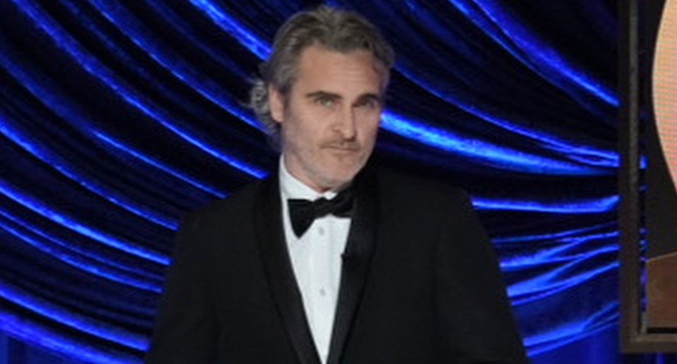 Joaquin Phoenix on stage at the 2021 Oscars (Getty)
