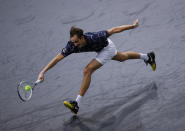 Russia's Daniil Medvedev stretches to return the ball to Germany's Alexander Zverev during the Paris Masters tennis tournament final, Sunday, Nov. 8, 2020 in Paris. (AP Photo/Christophe Ena)