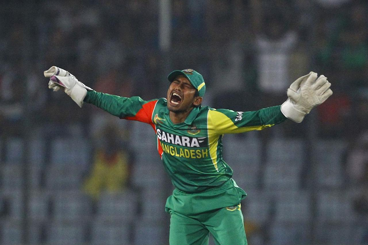 Bangladesh's Anamul Haque celebrates the wicket of Pakistan's captain Misbah-ul-Haq during their match in the Asia Cup one-day international cricket tournament in Dhaka, Bangladesh, Tuesday, March 4, 2014. (AP Photo/A.M. Ahad)