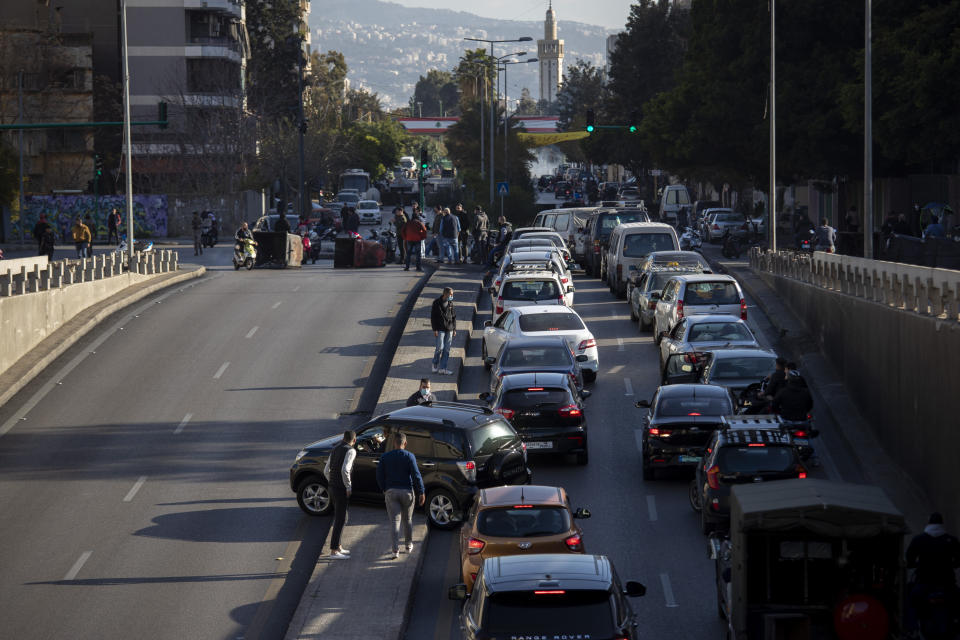 Cars are caught in a traffic jam as protesters block a main road that links the Lebanese capital Beirut to the southern suburbs, Wednesday, March 17, 2021. (AP Photo/Hassan Ammar)