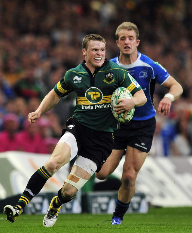 Northampton Saints' English winger Chris Ashton runs with the ball during the Heineken Cup Final match against Leinster at the Millennium Stadium in Cardiff on May 21, 2011. AFP PHOTO/GLYN KIRK NOT FOR MARKETING OR ADVERTISING USE/RESTRICTED TO EDITORIAL USE (Photo credit should read GLYN KIRK/AFP/Getty Images)