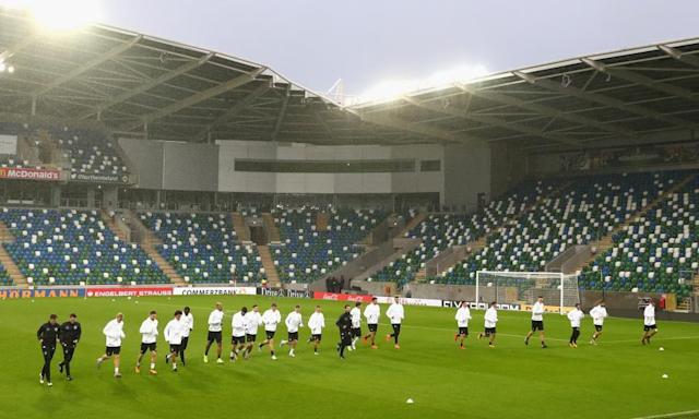 """<span class=""""element-image__caption"""">The Germany squad warm up on the Windsor Park pitch on the eve of their World Cup qualifier against Northern Ireland.</span> <span class=""""element-image__credit"""">Photograph: Alexander Hassenstein/Bongarts/Getty Images</span>"""