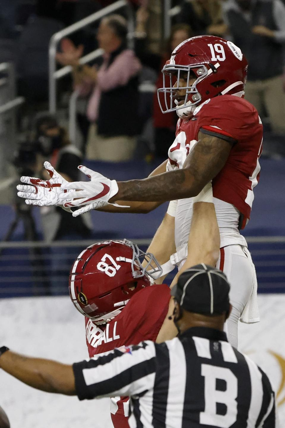Alabama tight end Miller Forristall (87) and tight end Jahleel Billingsley (19) celebrate Billingsley's touchdown catch in the first half of the Rose Bowl NCAA college football game against Notre Dame in Arlington, Texas, Friday, Jan. 1, 2021. (AP Photo/Michael Ainsworth)