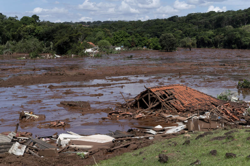 Dam collapse floods Brazil community with mining waste