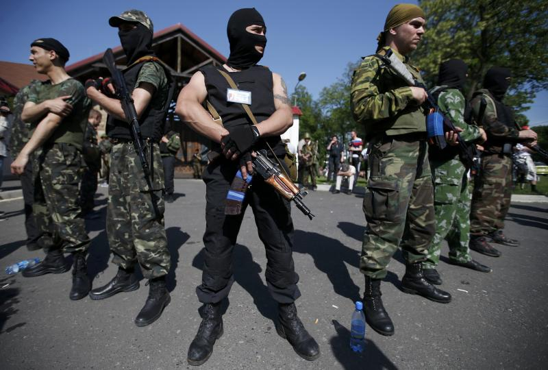 Pro-Russian separatists stand guard outside the house of Rinat Akhmetov in the eastern city of Donetsk