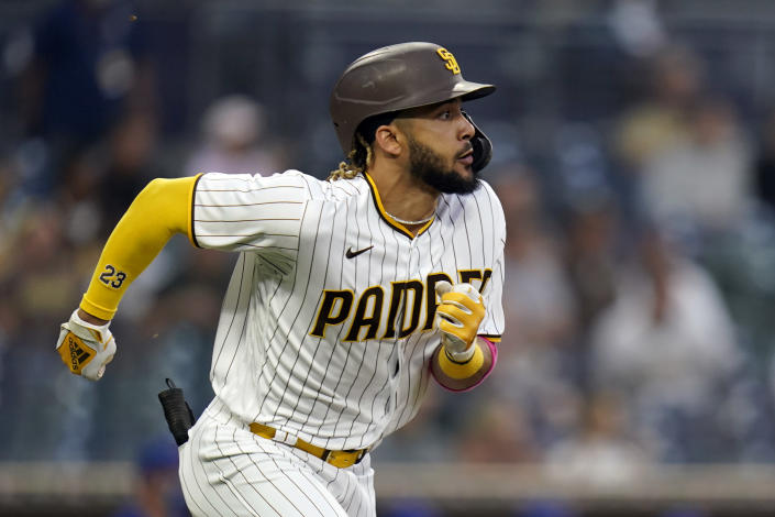San Diego Padres' Fernando Tatis Jr. runs to first as he lines out during the second inning of the team's baseball game against the Chicago Cubs, Tuesday, June 8, 2021, in San Diego. (AP Photo/Gregory Bull)
