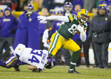 Jan 3, 2016; Green Bay, WI, USA; Green Bay Packers tight end Richard Rodgers (82) rushes with the football after catching a pass as Minnesota Vikings safety Andrew Sendejo (34) defends during the fourth quarter at Lambeau Field. Minnesota won 20-13. Mandatory Credit: Jeff Hanisch-USA TODAY Sports / Reuters Picture Supplied by Action Images (TAGS: Sport American Football NFL) *** Local Caption *** 2016-01-04T051341Z_407723349_NOCID_RTRMADP_3_NFL-MINNESOTA-VIKINGS-AT-GREEN-BAY-PACKERS.JPG