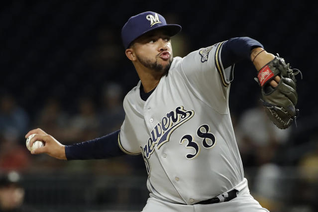 Milwaukee Brewers relief pitcher Devin Williams, in his debut in the majors, delivers during the sixth inning of the team's baseball game against the Pittsburgh Pirates in Pittsburgh, Wednesday, Aug. 7, 2019. (AP Photo/Gene J. Puskar)