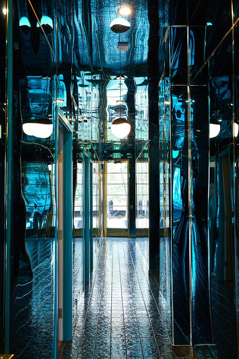 The entry is an aquamarine hall of mirrors.