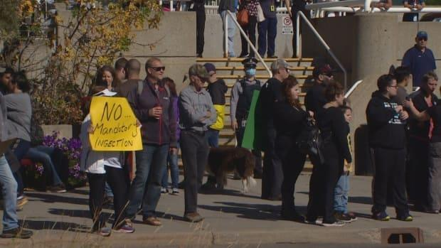 About 70 anti-vaccine protesters stood outside the Royal Alexandra Hospital in Edmonton on Monday. A group opposed to mandatory vaccinations for health care workers and vaccine passports organized protests at hospitals across Canada.  (Peter Evans/CBC  - image credit)