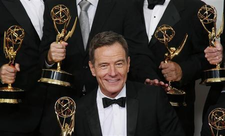 """Actor Bryan Cranston from AMC's series """"Breaking Bad"""" poses backstage with his award for Outstanding Drama Series"""
