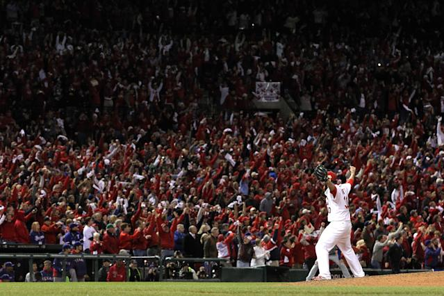 ST LOUIS, MO - OCTOBER 28: Jason Motte #30 of the St. Louis Cardinals celebrates after defeating the Texas Rangers 6-2 to win the World Series during Game Seven of the MLB World Series at Busch Stadium on October 28, 2011 in St Louis, Missouri. (Photo by Jamie Squire/Getty Images)