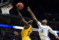 <p>Jayvon Graves #3 of the Buffalo Bulls reaches to block Luguentz Dort #0 of the Arizona State Sun Devils during the first half of the first round game of the 2019 NCAA Men's Basketball Tournament at BOK Center on March 22, 2019 in Tulsa, Oklahoma. </p>