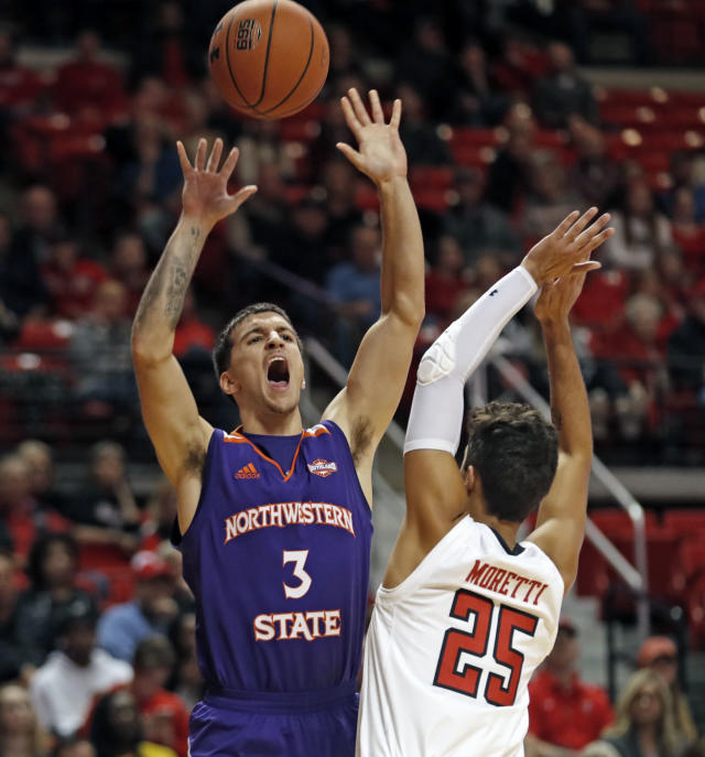 Texas Tech's Davide Moretti (25) breaks up the shot by Northwestern State's Alex Comanita (3) during the first half of an NCAA college basketball game, Wednesday, Dec. 12, 2018, in Lubbock, Texas. (AP Photo/Brad Tollefson)