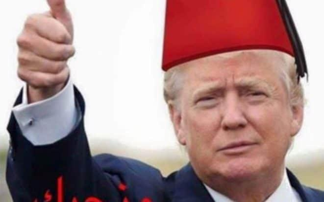 The US president is shown wearing a hat similar to a fez with the words: