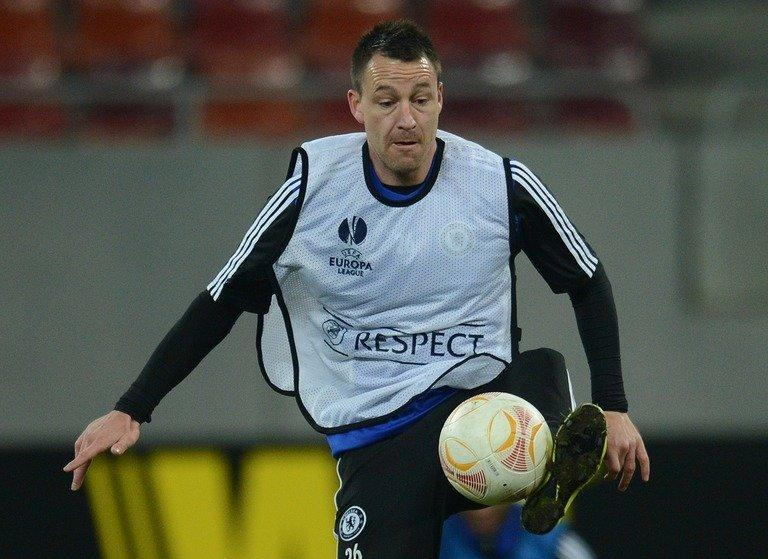 Chelsea defender John Terry takes part in a training session on March 6, 2013, the eve of the Europa League clash at Steaua Bucharest. The Blues are the first Champions League winners to exit at the group stage