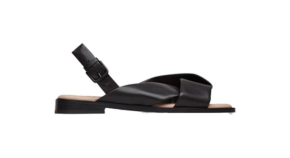 """<p>Cos is known for it's fashionable basics and we simply love these do-all tie-front sandals. They feel luxe yet will go with literally ANYTHING. <br><a rel=""""nofollow noopener"""" href=""""https://www.cosstores.com/en_gbp/women/shoes/product.knotted-leather-sandals-black.0599425003.html"""" target=""""_blank"""" data-ylk=""""slk:Buy here."""" class=""""link rapid-noclick-resp"""">Buy here.</a> </p>"""