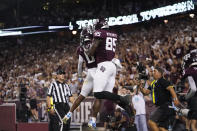 Texas A&M tight end Jalen Wydermyer (85) celebrates with wide receiver Ainias Smith (0) after scoring a touchdown agent Alabama during the first half of an NCAA college football game Saturday, Oct. 9, 2021, in College Station, Texas. (AP Photo/Sam Craft)