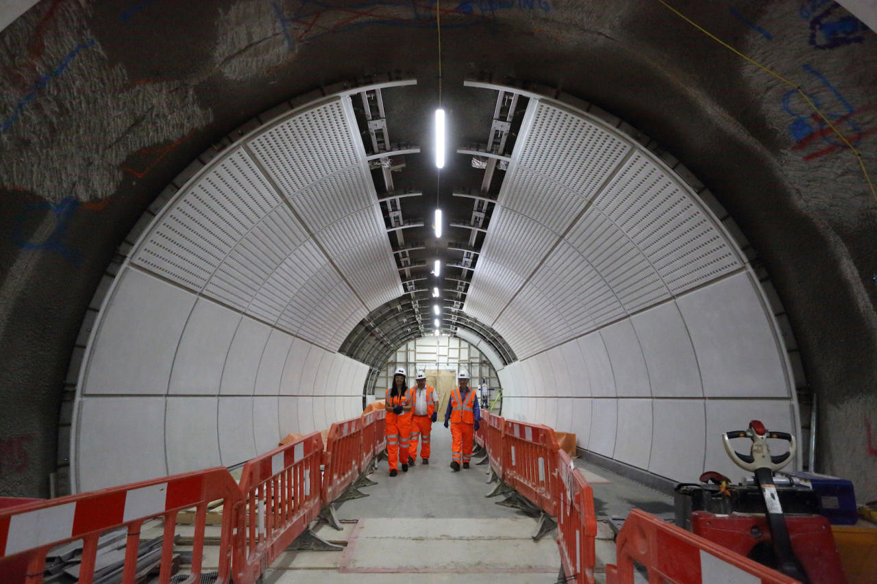 <p>Workers walk through Tottenham Court Road station. </p>
