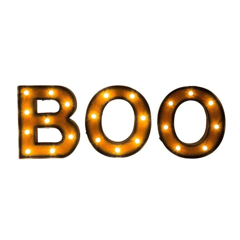 """<p>Add some light to your space with this <a href=""""https://www.popsugar.com/buy/Collections-Etc-Lighted-Halloween-Boo-Sign-353733?p_name=Collections%20Etc%20Lighted%20Halloween%20Boo%20Sign&retailer=amazon.com&pid=353733&price=39&evar1=savvy%3Auk&evar9=43787777&evar98=https%3A%2F%2Fwww.popsugar.com%2Fsmart-living%2Fphoto-gallery%2F43787777%2Fimage%2F43787994%2FCollections-Etc-Lighted-Halloween-Boo-Sign&list1=amazon%2Challoween%2Challoween%20decor%2Caffordable%20decor&prop13=api&pdata=1"""" rel=""""nofollow"""" data-shoppable-link=""""1"""" target=""""_blank"""" class=""""ga-track"""" data-ga-category=""""Related"""" data-ga-label=""""https://www.amazon.com/Glitzhome-Halloween-Marquee-Battery-Operated/dp/B074PPR59D/ref=sr_1_8?ie=UTF8&amp;qid=1532989149&amp;sr=8-8&amp;keywords=boo+sign"""" data-ga-action=""""In-Line Links"""">Collections Etc Lighted Halloween Boo Sign</a> ($39). </p>"""