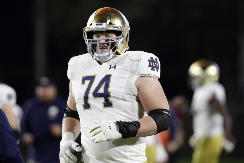 Notre Dame offensive lineman Liam Eichenberg isn't an elite athlete but has shown improvement as a pass blocker. (AP Photo/Gerry Broome)