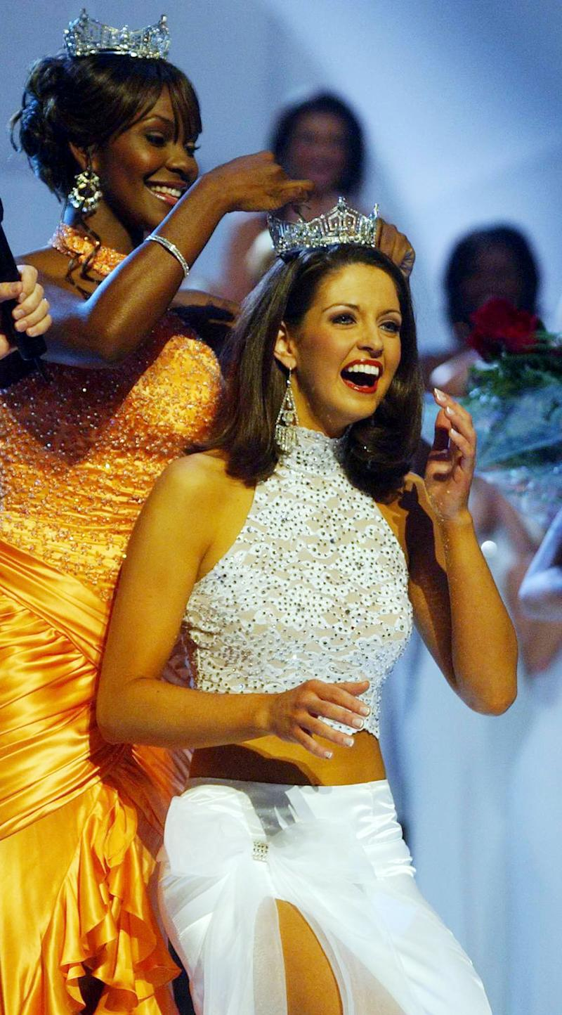 FILE - In this Sept. 18, 2004 file photo, former Miss America Ericka Dunlap, left, crowns Miss Alabama Deidre Downs, as Miss America 2005, during the Miss America Competition at the Atlantic City, N.J. (AP Photo/Brian Branch-Price)