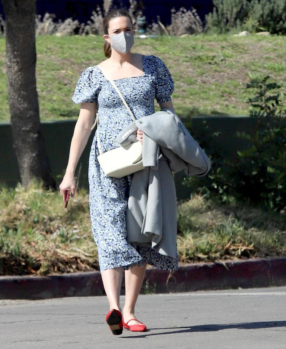 <p>Mandy Moore wears a baby blue dress and red flats while out for a walk in L.A. on Wednesday.</p>