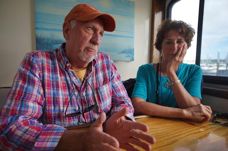 DENNIS, MA - AUGUST 27: Seth Stoffregen of Wellesley and friend Deborah Schilling, a realtor from Cotuit, take part in a cruise sponsored by AMR Asset Management Financial Resources in Dennis, MA on Aug. 27, 2019. Menacing rumbles from Wall Street echoed across the placid waters of Cape Cod Bay last week as a boatload of graying day trippers returned to Sesuit Harbor. It was meant to be a carefree outing: A Hyannis financial planning firm had chartered the S.S. Lobster Roll, a twin-diesel party boat, to fete about 50 clients. But even amid the seaborne laughter, passengers were rattled by the recent market turbulence. Like millions in or approaching retirement, they wondered how the mounting uncertainty might affect their financial future. (Photo by Barry Chin/The Boston Globe via Getty Images)