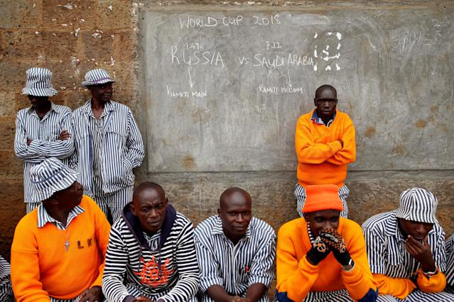<p>Kenyan prisoners watch a mock World Cup soccer match between Russia and Saudi Arabia at the Kamiti Maximum Security Prison, near Nairobi, Kenya, on June 14, 2018. (Photo: Baz Ratner/Reuters) </p>