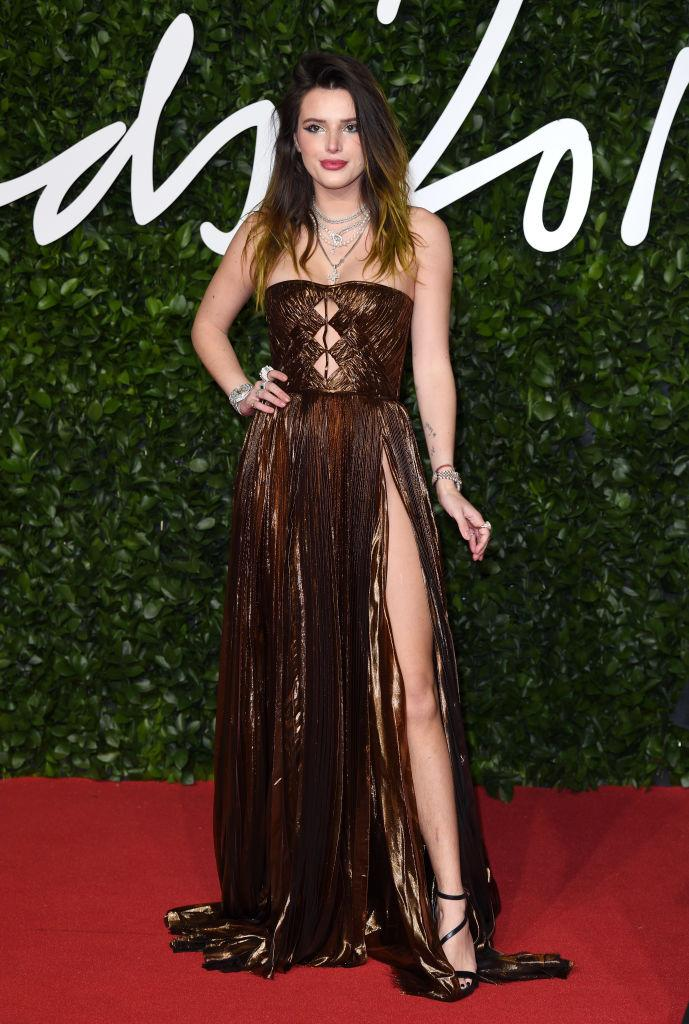 Bella Thorne rocked a daring split in her bronze, cut-away gown [Photo: Getty]
