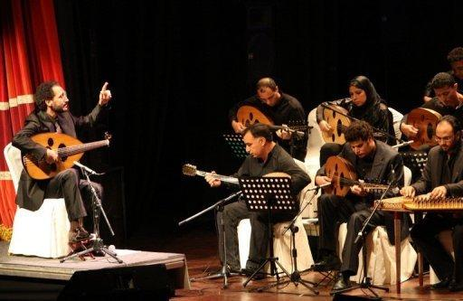 Naseer Shamma (L), Iraqi oud player, performs at the Royal Opera House in Muscat on September 27, 2010