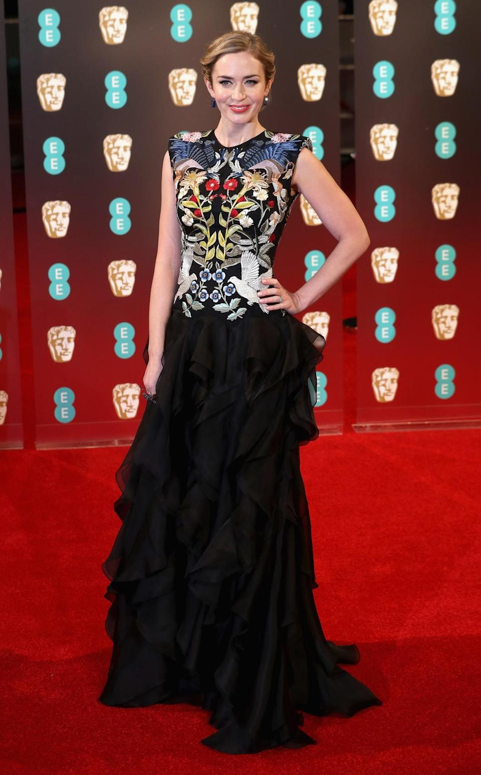 <p>Emily chose a dark Alexander McQueen look consisting of a tight-fitting embroidered top half and flowing skirt. <i>[Photo: Getty]</i> </p>