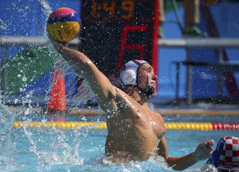 <p>Alex Obert of the U.S. team takes a shot midway through Saturday's match. (Reuters) </p>