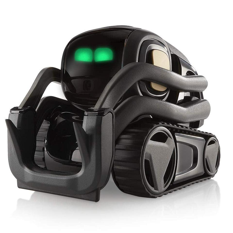 """<p>Consider this <span>Vector Robot by Anki</span> ($365) to be your new BFF.</p> <p>""""Vector is a companion made to hang out and help out,"""" the brand explains. """"Powered by AI and advanced robotics, he's alive with personality and engaged by sight, sound, and touch.""""</p>"""